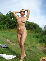 Nude Beach. Sexy blonde Milf nude on beach